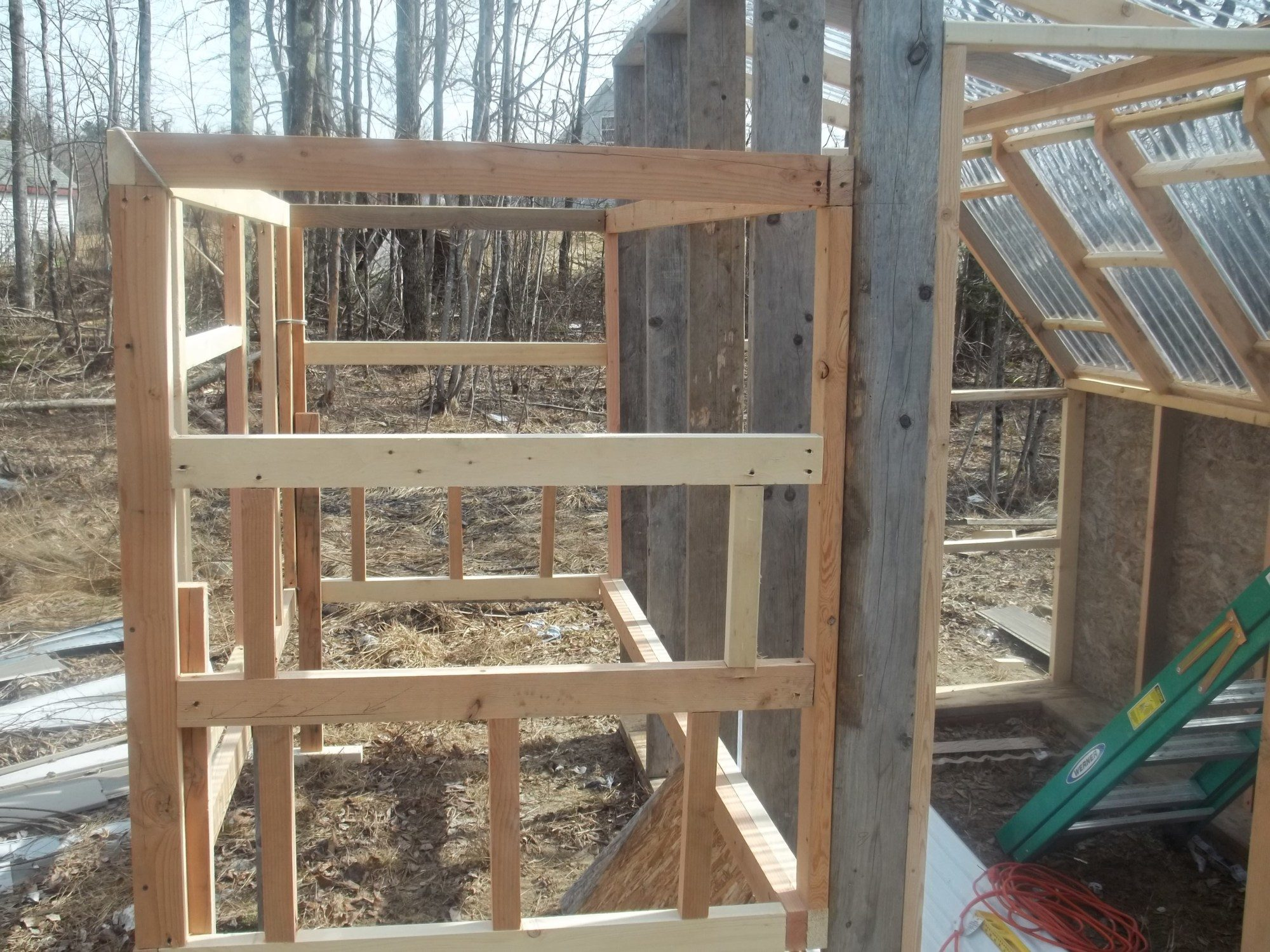 Side A for you firefighter types, you can see the framing for the nest box here.  Same on the opposite side.  Roof, walls, floor, and some fencing....almost there!