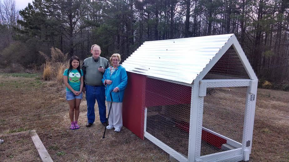 Mom and dad came over to see the coop I just built.