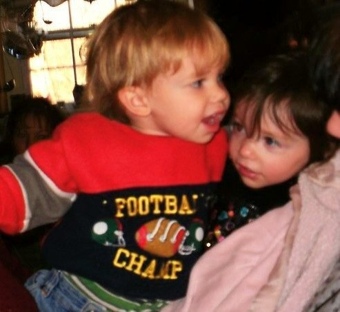 2 of our 18 grand  children,