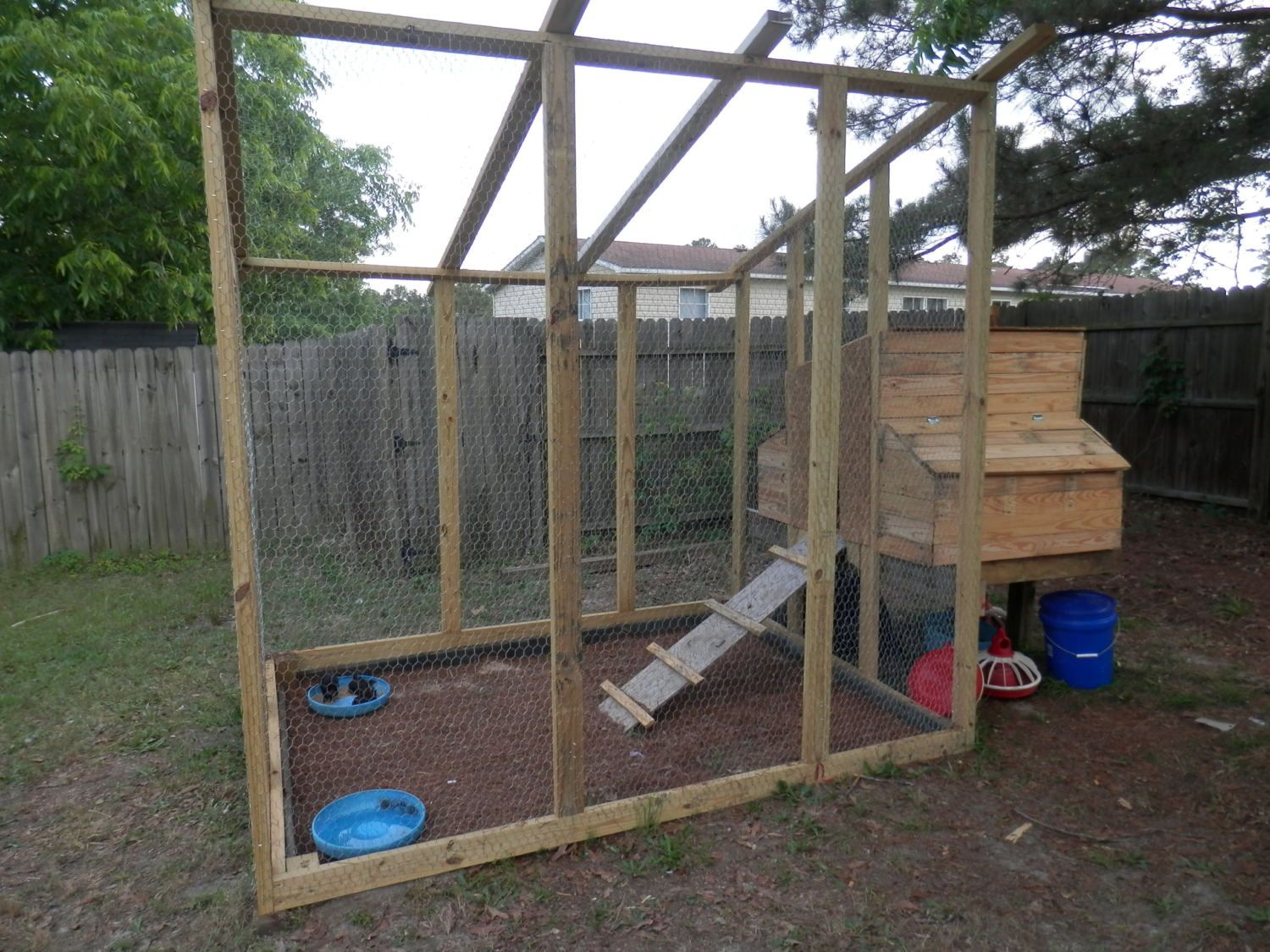 The chicken coop my husband and I built before we installed the tin roof.