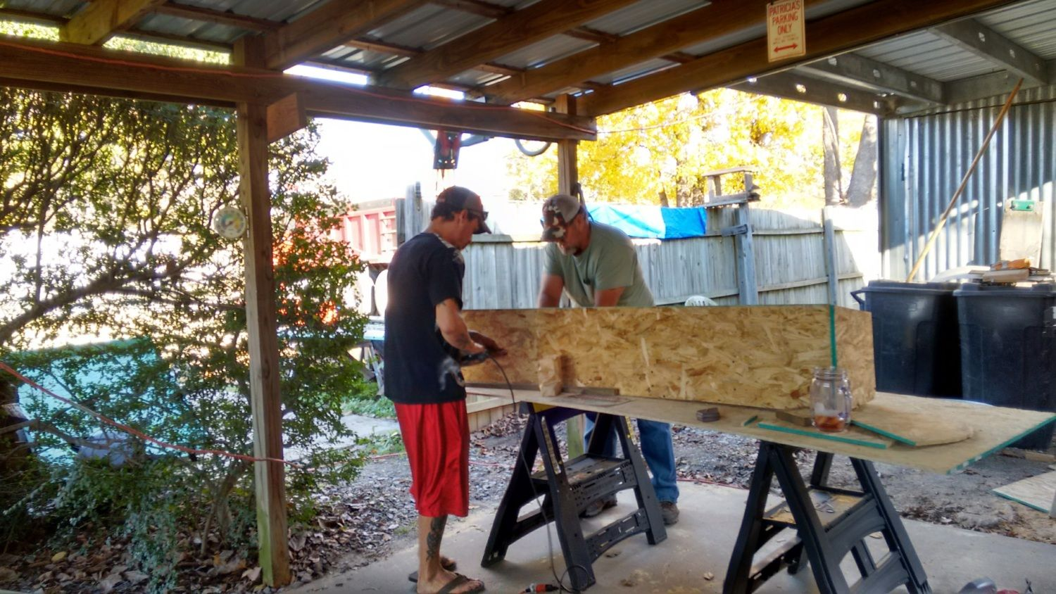 Dad and Son working on the bigger and better coop, hen house.
