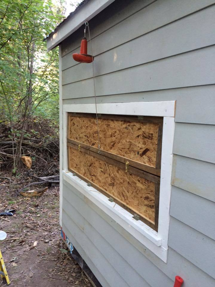 The doors to the nesting boxes. Notice the old boat anchor? When the top door is raised it lowers and hold the door up.