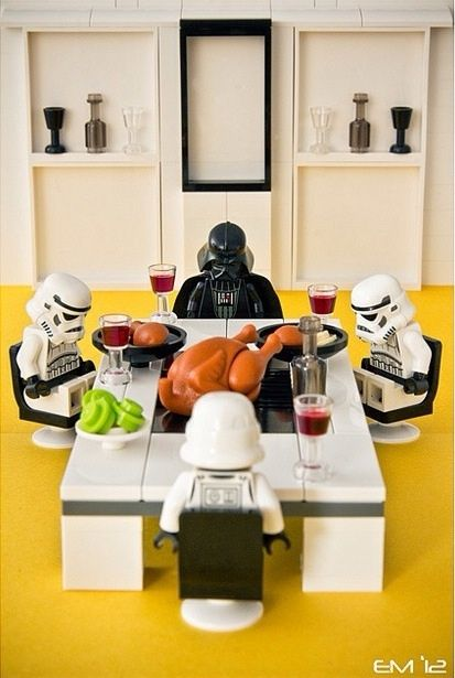 Darth Vader and Stormtroopers saying grace before their Thanksgiving feast.