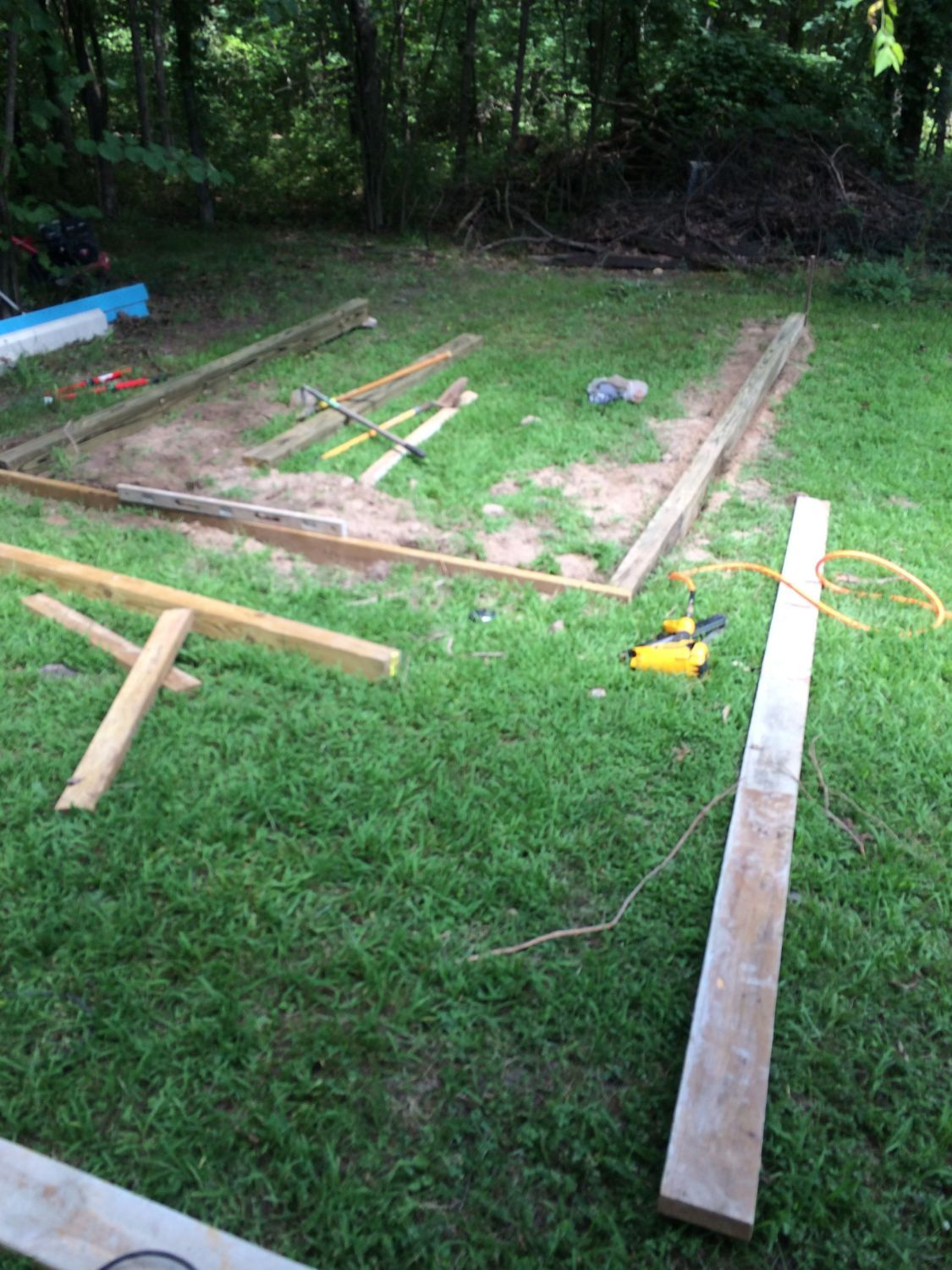 Here we have the 4'x6 pressure treated beams and PT 2x6's for the ends. I buried it in the ground to get it level as well as help keep critters from getting under it.