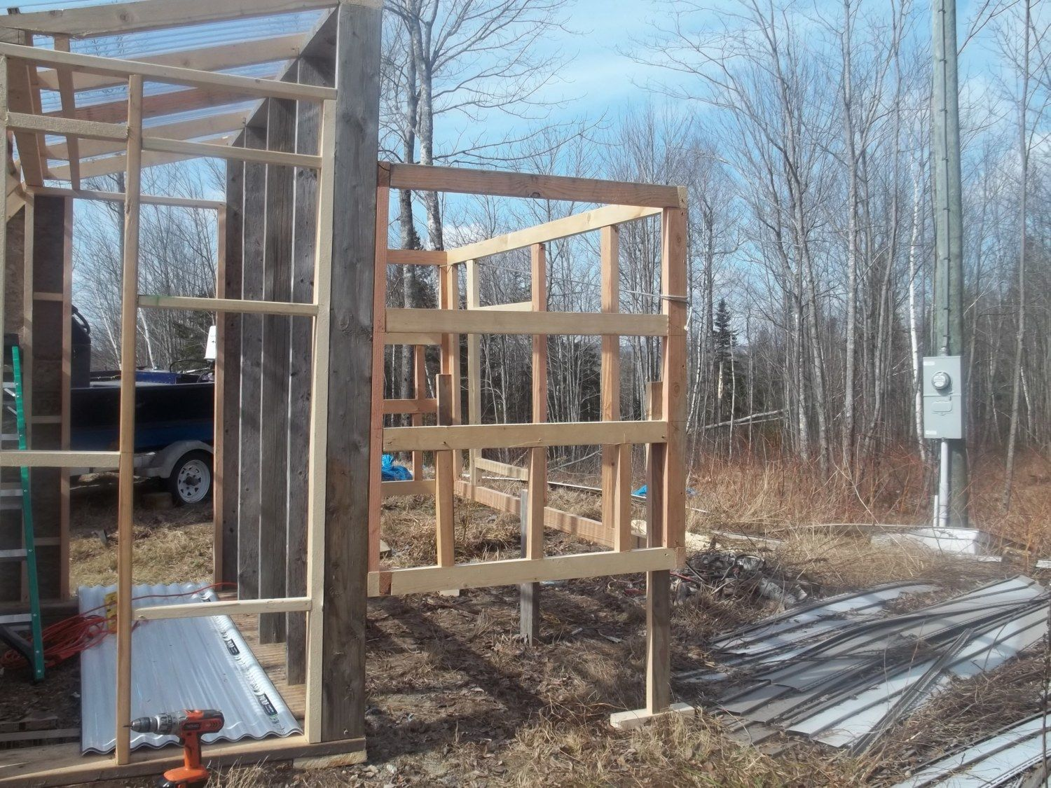 Day two:  Coop framed.  nesting box on each side...6 boxes, 13 laying hens