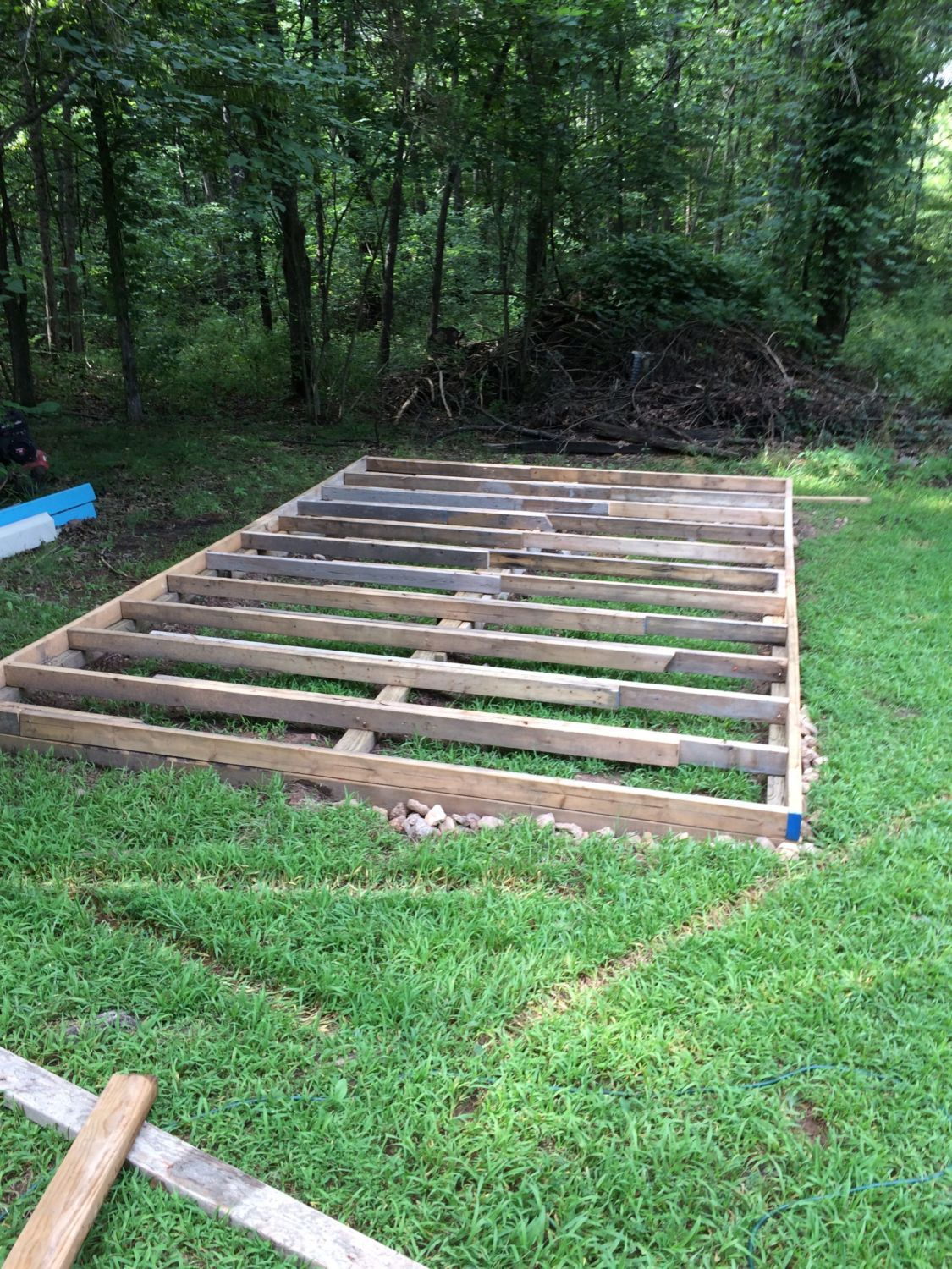 "Used 2x4's for the rim and floor joists. Spaced out the joists 16"" on center."